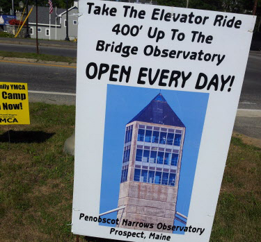 These roadsigns, erected by Friends of Fort Knox to draw attention to the Penobscot Narrows Bridge Observatory, were ordered removed Monday by the Maine Department of Transportation.