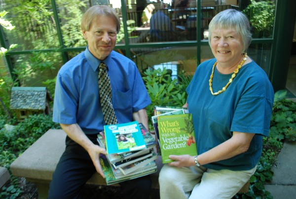 Donna Busch, chair of Belfast Garden Club Book Committee,  presents a donation of gardening and horticultural related books to Steve Norman, director, Belfast Free Library.