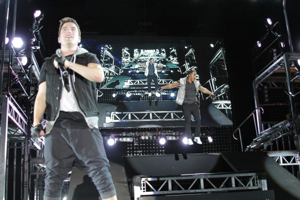 Big Time Rush members bounce on a giant trampoline on stage Friday night at the Bangor Waterfront.