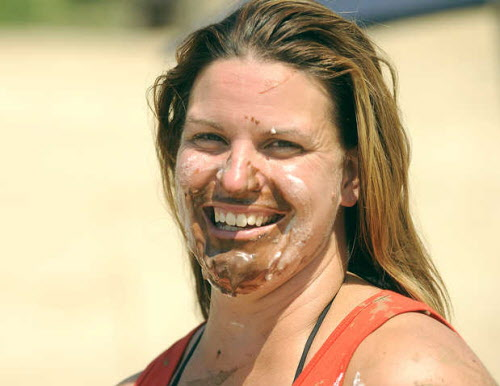 Rebecca Daoust of Tilton, N.H., smiles after her third-place finish in the pie-eating contest at the Redneck Blank in Hebron on Saturday, Aug. 4, 2012.