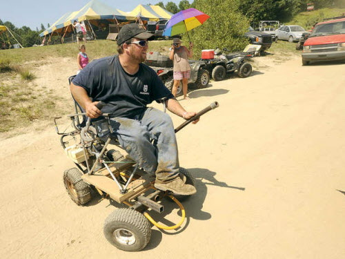 Andy Bell of Raymond gets around the Redneck Blank on his motorized lawn chair in Hebron on Saturday, Aug. 4, 2012.
