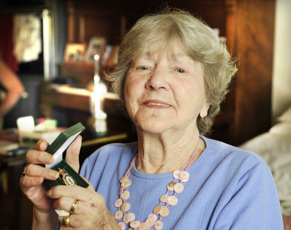 Marie Martin Giguere, 87, of Sabattus holds a medal awarded to her by the British government for her World War II service in England's Women's Land Army.