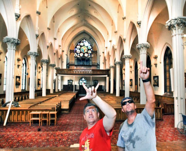 Michael Miclon (left) and his key grip, production manager, set director, set builder and &quotjack-of-all-trades&quot Dave Tardy talk Wednesday, Aug. 15, 2012 about what needs to be done to the interior of the former St. Patrick's Church on Bates Street in Lewiston to ready it for next week's filming of scenes for &quotRichard 3,&quot a feature-length comedy based on Shakespeare's &quotRichard III.&quot