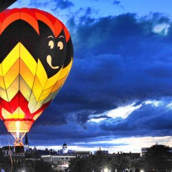 "Going Batty lights up in the evening sky as it does a ""balloon glow"" Satruday night at the Great Falls Balloon Festival in Simard-Payne Memorial Park in Lewiston."