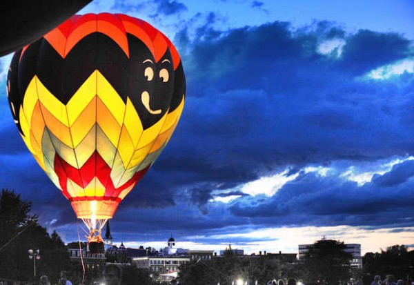 Going Batty lights up in the evening sky as it does a &quotballoon glow&quot Satruday night at the Great Falls Balloon Festival in Simard-Payne Memorial Park in Lewiston.
