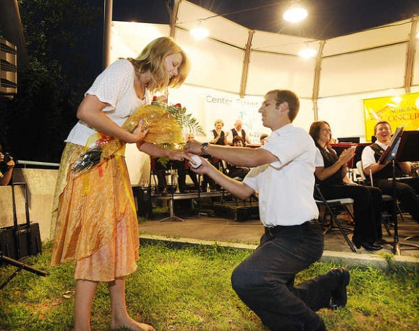 Luther Schalk, a percussionist with the Auburn Community Concert Band, gets down on one knee as he places a ring on Victoria James' finger. Schalk asked James to marry him during the Wednesday night, Aug. 1, 2012 concert before hundreds of concert-goers at Festival Plaza.