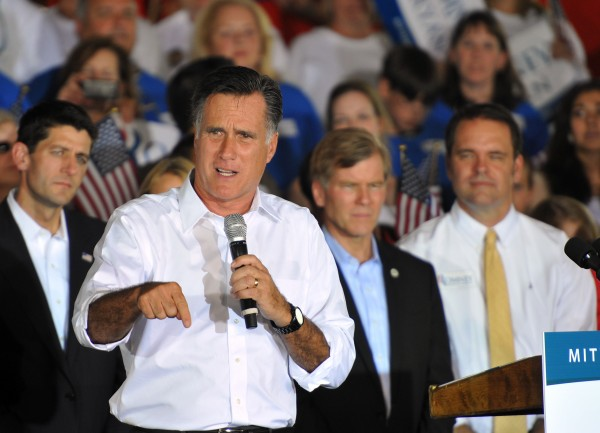 In this photo provided Patrick Kelley, Republican Presidential candidate Mitt Romney speaks during a campaign rally in Manassas, Va., Saturday, Aug. 11, 2012. Romney announced Wisconsin Rep. Paul Ryan, background left, as his running mate during an event in Norfolk, Va.