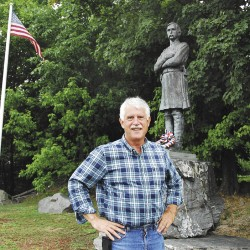 Dick Campbell stands in the park he and Brian Higgins, former head of the Brewer Historical Society, designed, while Col. Joshua Chamberlain stands behind him and the American flag waves. Campbell will host a tour of the Chamberlain Freedom Park, at North Main and State Streets in Brewer, this Tuesday, August 21 at 5:30 p.m.