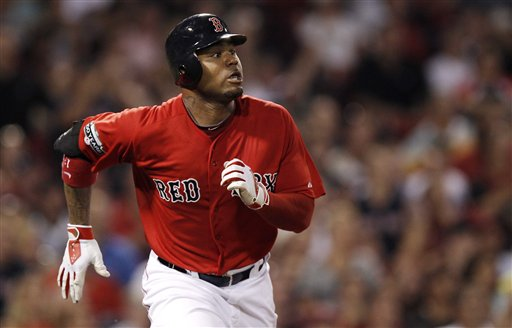 The Boston Red Sox's Carl Crawford watches his three-run home run against the Minnesota Twins during the third inning of Friday's baseball game at Fenway Park in Boston.