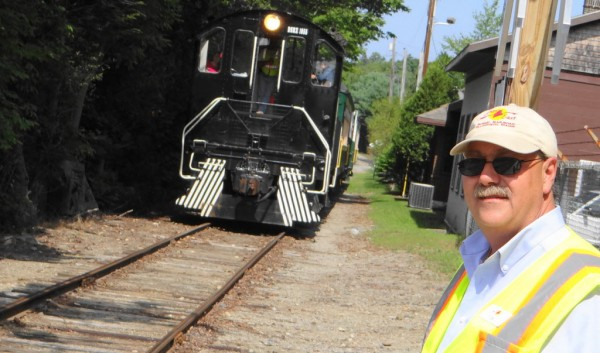 Tom Testa, president of the nonprofit Downeast Scenic Railroad, waits for Saturday's train to return to the boarding area in Ellsworth. The trains run twice a day on Saturdays and Sundays.