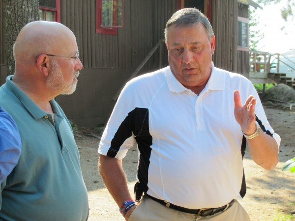David Kotok (left) chats with Maine Gov. Paul LePage at Leen's Lodge in Grand Lake Stream.