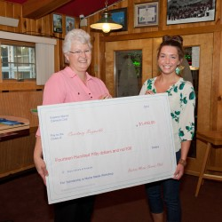 Courtney Reynolds is presented her award of the Frank Howd Memorial Scholarship by Jeanne Caron, President of the Eastern Maine Camera Club