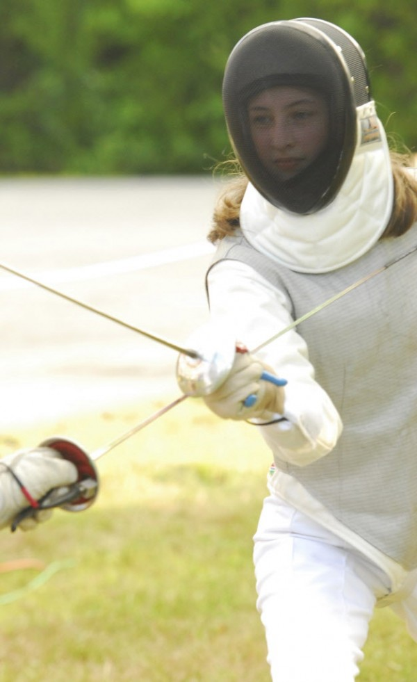 Joanna Garneau of Garland puts on a fencing display aganist fencing instructor Cleon Grover, at WLBZ 2 in Bangor on Wednesday afternoon, Aug. 1, 2012.