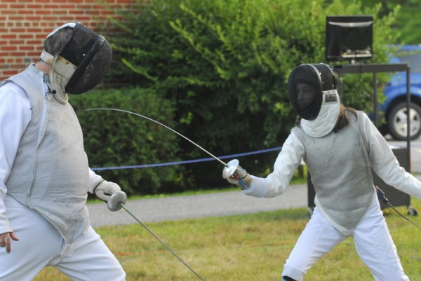 Joanna Garneau (right) of Garland puts on a fencing display aganist fencing instructor Cleon Grover, at WLBZ 2 in Bangor on Wednesday afternoon, Aug. 1, 2012. The TV station held the event to coincide with the Olympics.