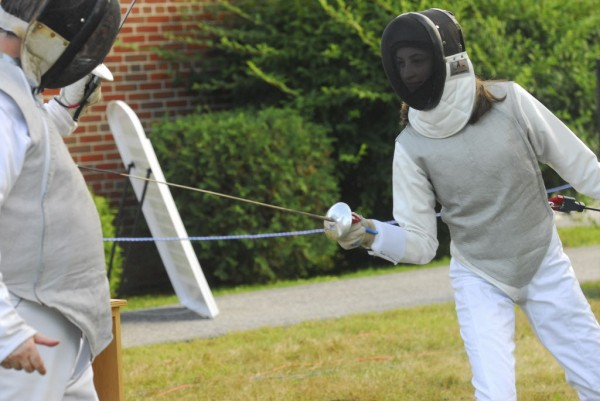 Joanna Garneau of Garland (right) puts on a fencing display with fencing instructor Cleon Grover, at WLBZ 2 in Bangor on Wednesday afternoon, Aug. 1, 2012.