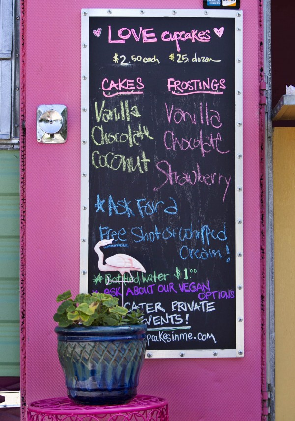 The menu on Love Cupcakes' chalkboard changes daily. In addition to the staples, vanilla and chocolate, the food truck sometimes offers cakes that range from carrot to strawberry, and frostings that include peanut butter and watermelon.