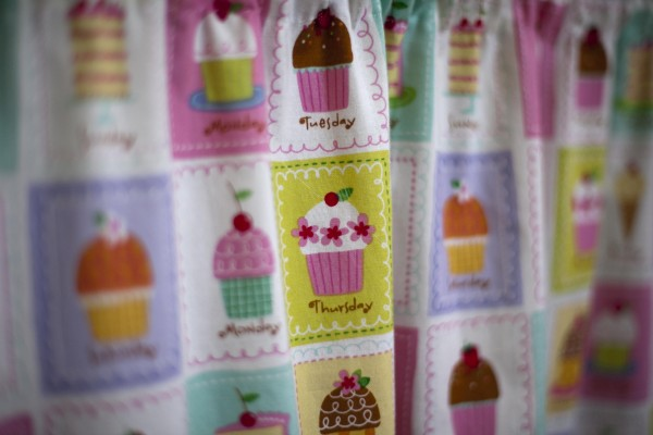 Cupcake curtains made by the owner's grandmother add to the ambience inside the Love Cupcakes trailer.