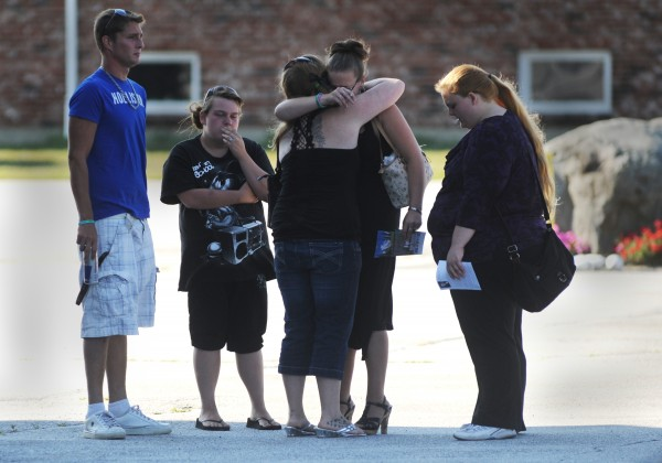 Family and friends console one another outside Bangor Baptist Church after Sunday afternoon's memorial service for Nicolle Lugdon.