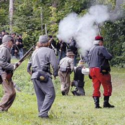 Confederate, Union soldiers battle during encampment in Fairfield