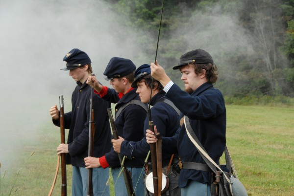 During the &quotWe Are Coming, Father Abraham&quot Civil War encampment held at Good Will Hinckley School in Fairfield on Saturday, Aug. 25, 2012, four Union re-enactors load their weapons. They are (from left) Tom Campbell of Cape Elizabeth; Ryan Middleton of Oromocto, New Brunswick; Cornelius Donovan V of Brunswick; and Ben Custer of Palermo.
