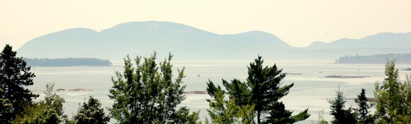 The lazy, hazy days of summer descended upon Hancock County on Wednesday, Aug. 8, 2012, leaving the mountains of Mount Desert Island peeking through the haze from across Frenchman Bay in Sullivan.