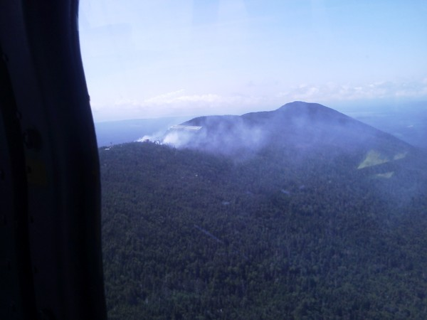 Maine Forest Rangers and other emergency workers battle a wildfire covering about two acres on top of Big Spencer Mountain in Piscataquis County on Sunday, Aug. 5, 2012.