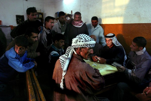 NONELocal Amara men play dominoes, a popular Iraqi pass time, in a local coffee shop.