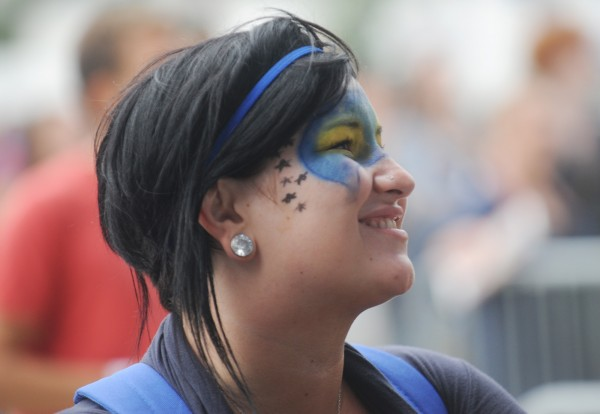 Bangor native Mika Marshall of Portland takes in the percussive riffs of Reptar with the rest of the KahBang crowd at the Main Stage on Bangor's waterfront, Friday evening, Aug. 10, 2012. She said a friend applied the facepaint.