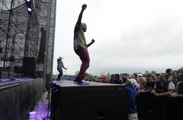 Fredua Boakye (foreground) and Santiago Araujo, two members of the Boston-based indie pop/ funk/R&B/ band Bad Rabbits,  jump on front mega speakers to get closer to the KahBang festival crowd during their performance on the Main Stage on Bangor's waterfront Friday evening, Aug. 10, 2012.