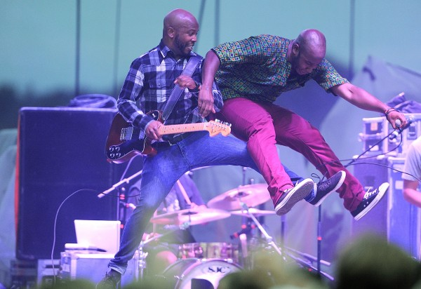 Santiago Araujo (left) and Fredua Boakye, two members of the Boston-based indie pop/ funk/R&B/ band Bad Rabbits, slam into each other on stage during their concert Friday night at the KahBang festival on Bangor's waterfront.