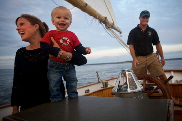 Colt Mitchell, enjoys the 6 p.m. sail aboard the 100-year-old Wendemeen on Monday, Aug. 13, 2012 with his mother Kris and Capt. Ryan Langley.