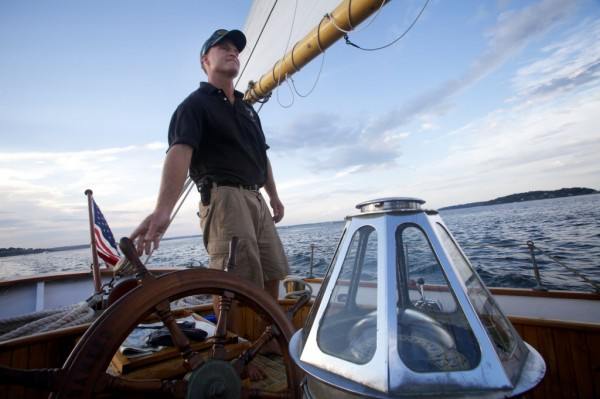Capt. Ryan Langley of the Portland Schooner Company pilots the Wendemeen in Portland Harbor on Monday evening, Aug. 13, 2012.