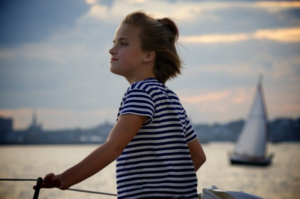 Emma Mitchell, 9, looks out on Portland Harbor from the rail of the Portland Schooner Company's 100-year-old Wendemeen on Monday night, Aug. 13, 2012. Mitchell was visiting Maine with her family from Ohio.