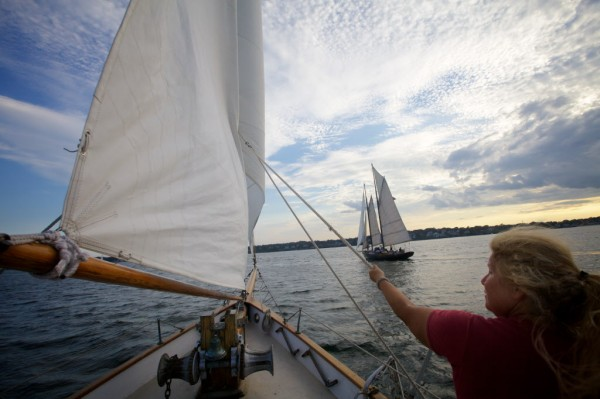 Sandra Silver of the Portland Schooner Company handles a sail aboard the Wendemeen on Monday night, Aug.13, 2012 while sister ship the Bagheera is seen ahead.