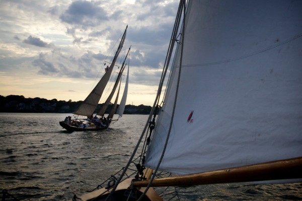 The Portland Schooner Company's sister ships, Bagheera (ahead) and Wendemeen engage in a low-key and friendly race on Portland Harbor on Monday night, Aug. 13, 2012.