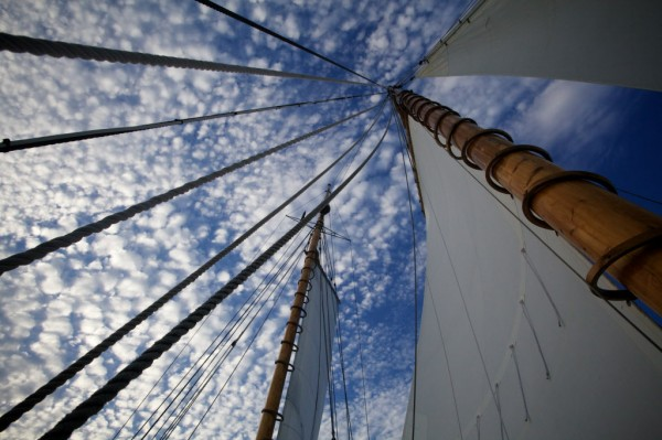 The 100-year-old Wendemeen's fore and aft masts of white pine tower into the late afternoon sky Monday, Aug. 13, 2012 on Casco Bay. The ship is owned by the Portland Schooner Company.