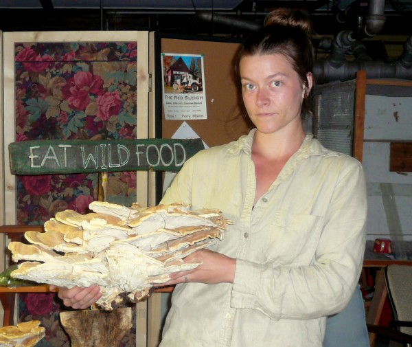 The organic and natural foods available through Machias Marketplace sometimes include the exotic. Buyers' club member Jenna Rozella shows off a wild chicken of the woods mushroom recently included in the market's inventory of locally harvested foods.