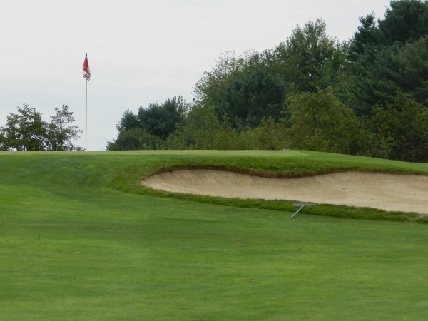 Reaching the green of the par-3 fourth hole at Mere Creek Golf Course can present a challenge for golfers. With a 149-yard uphill tee shot, players should try and avoid falling short of the green with the bunker in front
