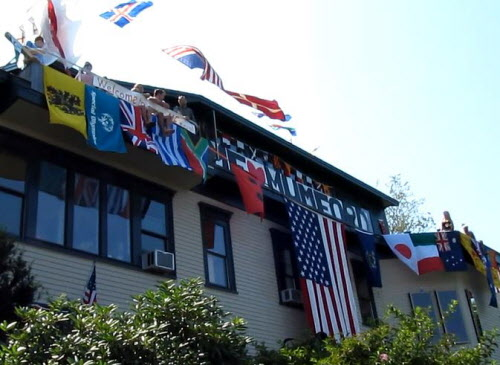 This Eastern Promenade home was decorated with flags from around the world and a banner welcoming the hit British folk rock band Mumford & Sons on Saturday, Aug. 4, 2012. The band brought its Gentlemen of the Road Festival to Portland and event organizers said band members would be picking the best-decorated home in the area for a personal visit, spurring many homeowners on the Eastern Prom to get colorful.