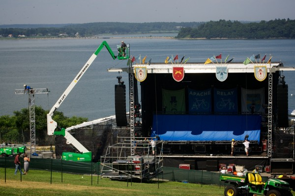 Workmen erect one of two stages in Portland's Eastern Promenade park Friday, August 3, 2012, in preparation for the Mumford and Sons &quotGentlemen of the Road&quot tour stop Saturday.