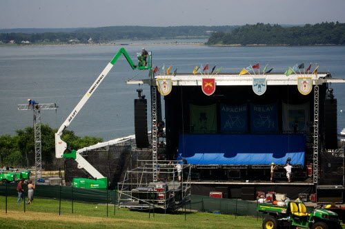 Workmen erect one of two  stages in Portland's Eastern Promenade park on Friday, Aug. 3, 2012 in preparation for the Mumford & Sons &quotGentlemen of the Road&quot tour stop Saturday.