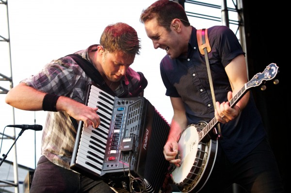 Tim Brennan (left) and Jeff DaRosa of the Dropkick Murphys play on stage in Portland Saturday night August 4, 2012, on the Eastern Promenade.