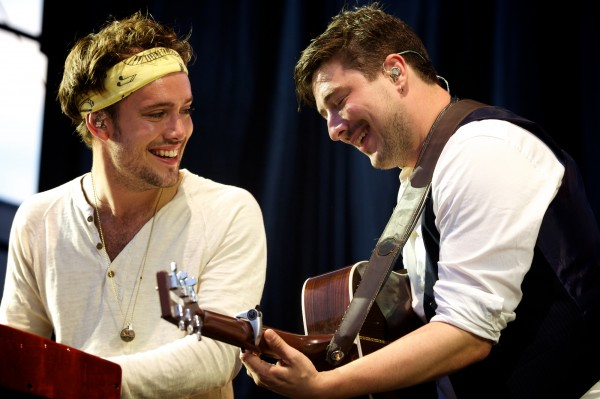 Ben Lovett (left) and Marcus Mumford of Mumford & Sons play off each other at a concert in Portland Saturday night August 4, 2012.