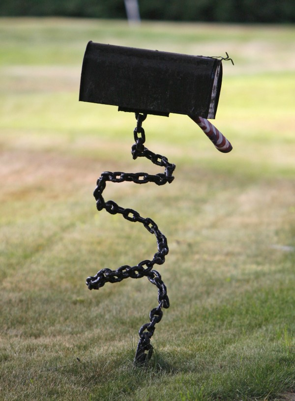 A post made of welded chain supports a mailbox on Ferry Road in Saco.
