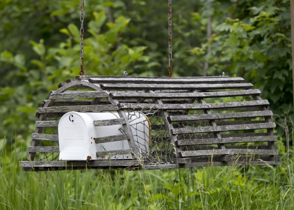 A wooden lobster trap houses a mailbox near Biddeford Pool.