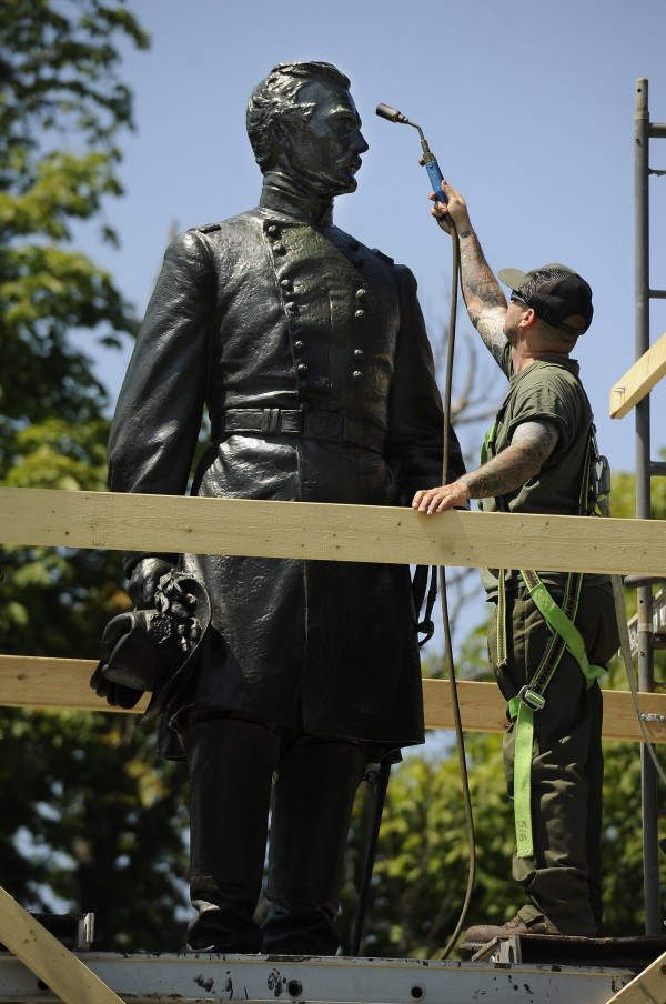 Jamie Revis works on a statue of Maj. Gen. Andrew Humpreys within the Fredericksburg National Cemetery at the Fredericksburg and Spotsylvania County Battlefields Memorial National Military Park in Fredericksburg, VA. The park faces financial constraints that affect staffing and repairs that have to be put on hold.