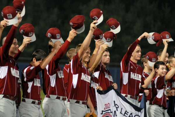 The Maine District 3 baseball team acknowledges a cheering crowd during the opening ceremony the 2012 Senior League World Series at Mansfield Stadium Saturday night.