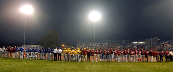Teams line the field at Mansfield Stadium for the opening ceremony of the 2012 Senior League World Series at Saturday night.