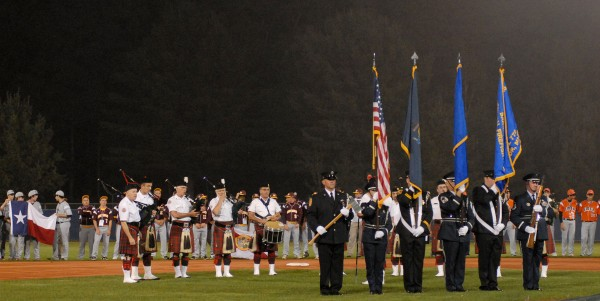 Teams line the field behind the Maine State and Bangor Fire Department Honor Guards and the Anah Highlanders at Mansfield Stadium for the opening ceremony of the 2012 Senior League World Series on Saturday night.