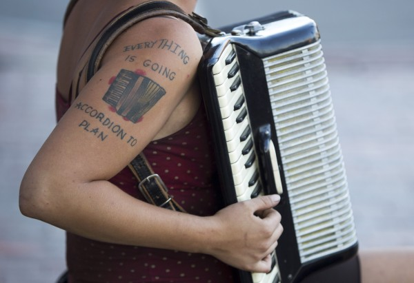 A tattoo is displayed on self-taught accordian player Josie English on Sunday, Aug. 26, 2012, in Portland. &quotI understand music theory. I played piano for eight years as a kid, and I played French horn. When I started traveling, a friend suggested we get some instrument. I'm not the best accordian player but I'm a pretty good street performer,&quot she said.
